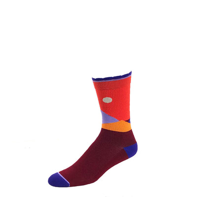 Designer performance compression crew sock featuring moonlit mountaintops design in orange