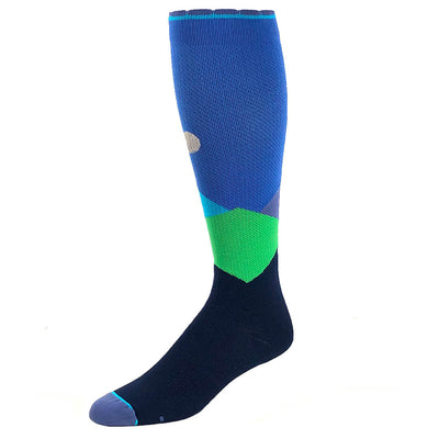 Designer performance compression sock featuring moonlit mountaintops design in shades of blue