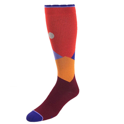 Designer performance compression sock featuring moonlit mountaintops design in orange
