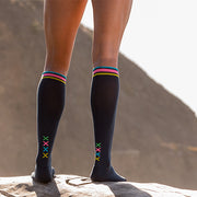 Solid slate compression sock with four multi-colored XXXXs at the ankle for runners, hikers, cyclists, travelers.
