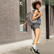 Woman with backpack walking in herringbone gray compression crew socks