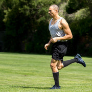 Runner in field wearing slate compression socks