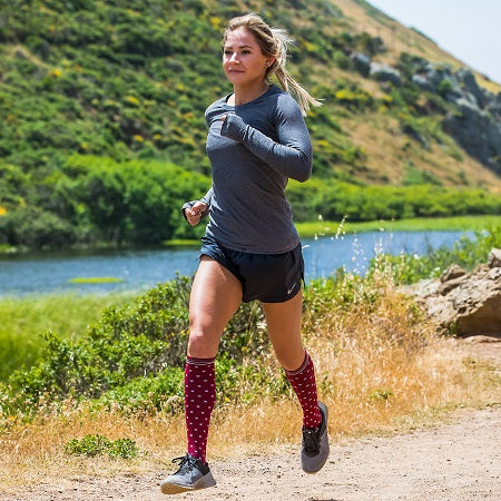 Female Trail Runner wearing Lily Trotters In-Stitches Brick