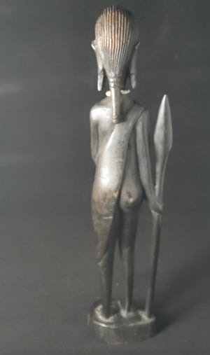 Kenyan Woman Carving