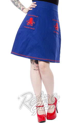 Sourpuss Suzie Skirt in cobalt Blue with red emboidered Octopus applique on pockets full length front