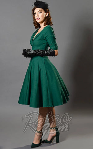 Unique Vintage Delores Swing Dress in Green model
