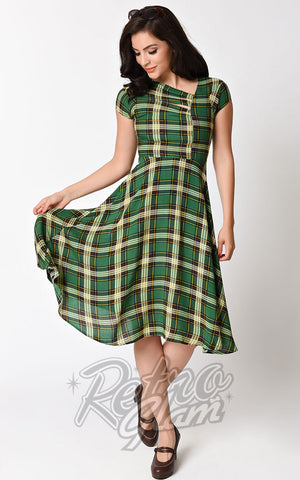Unique Vintage green and gold plaid Amelia Dress with asymmetrical neckline, capped sleeves, nipped waist, and full skirt front
