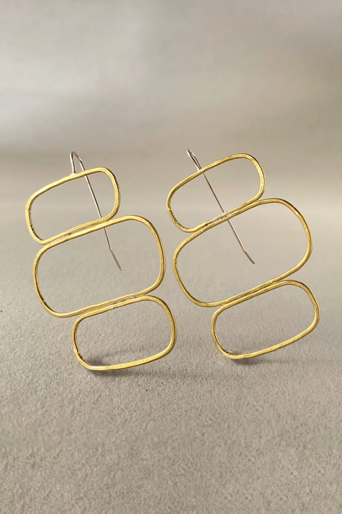 Achitectural modern earrings by Mahnal contemporary jewelry, named the Nasira Earrings