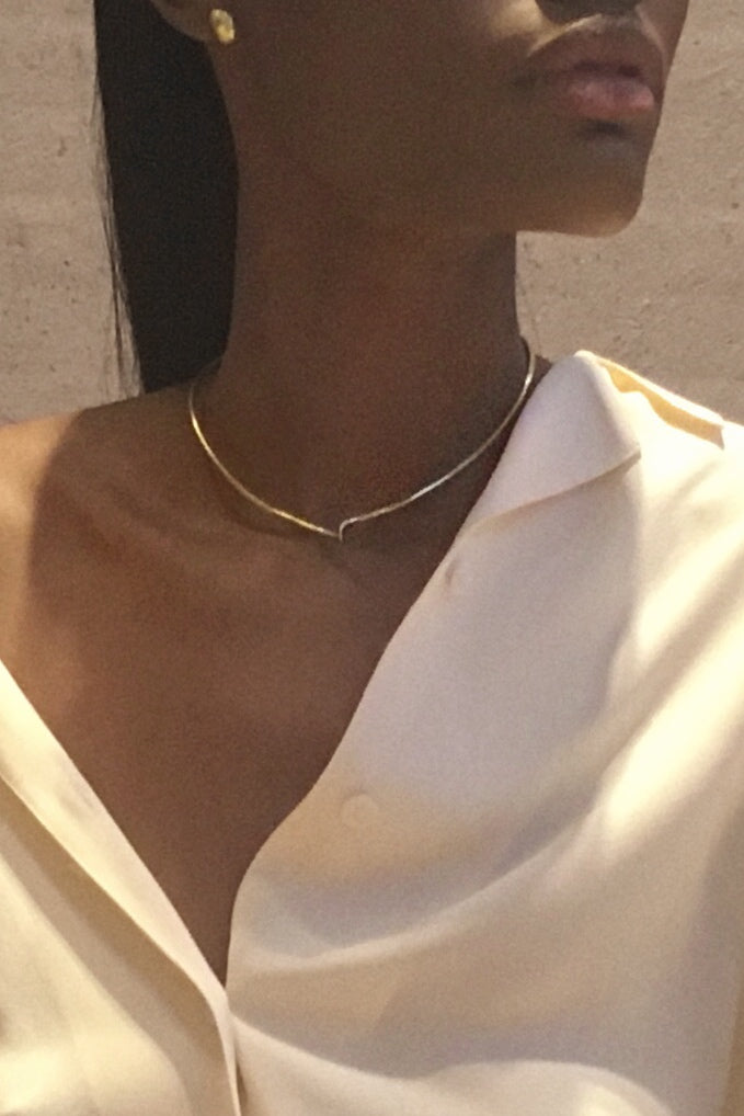 Handcrafted modern jewelry with a minimal collar necklace. Classic necklace in a wishbone style. Contemporary brass jewelry