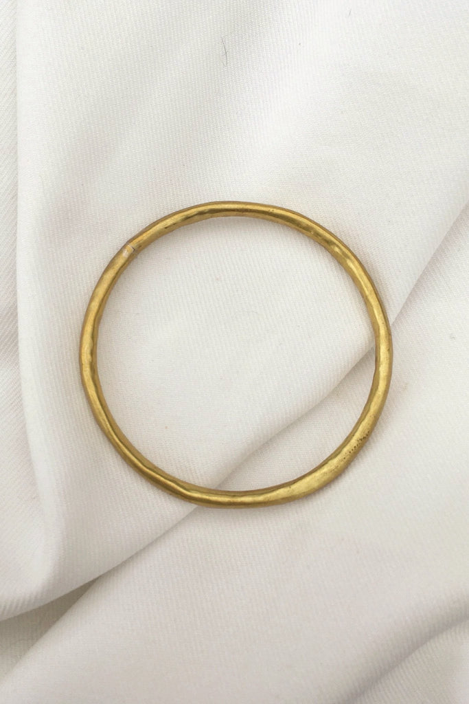 Classic, hollow, contemporary bangle with a modern jewelry style. Contemporary bangle or modern brass jewelry.