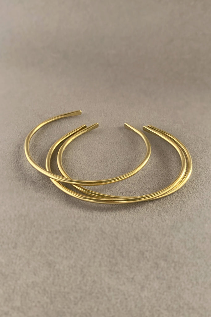 Delicate stacking bangles in a minimal style. Three simple stackable bracelets by Mahnal