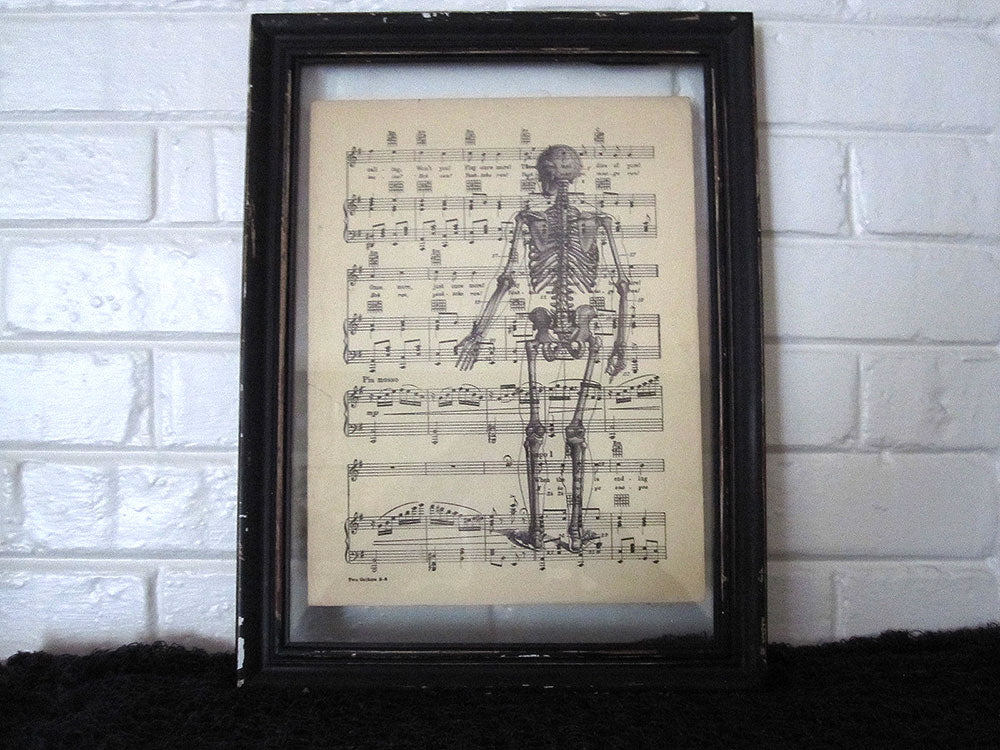 Standing Skeleton Back Art Print on Vintage Music Sheet