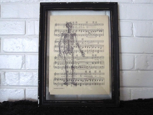 Standing Skeleton Front Art Print on Vintage Music Sheet