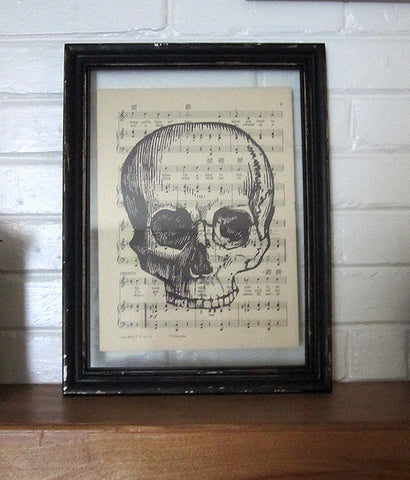 Skull Without Jaw Art Print on Vintage Music Sheet