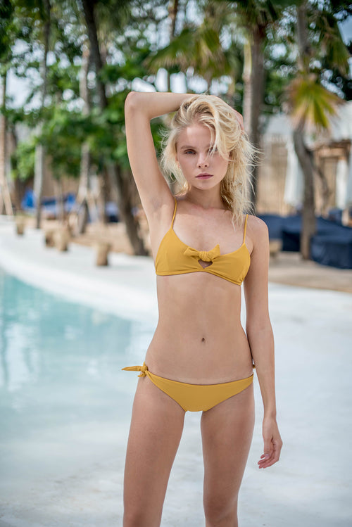 knot tie bikini top in mustard by storm swimwear