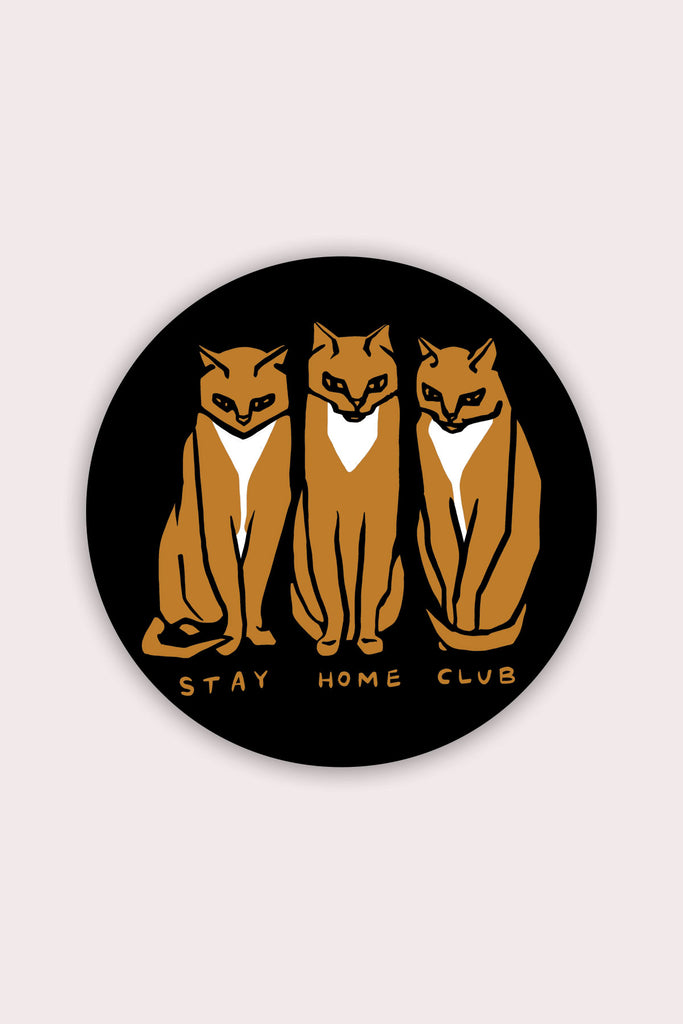 circle sticker of three orange and white cats on black background with orange text reading stay home club
