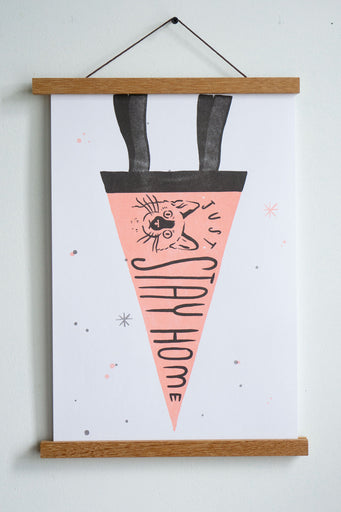 drawing of pink pennant with black trim with a drawing of cat and text just stay home in black font
