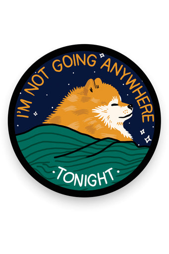 "circular sticker with small sleeping orange dog under green blanket on blue background encircled by the text ""I'm not going anywhere tonight"""