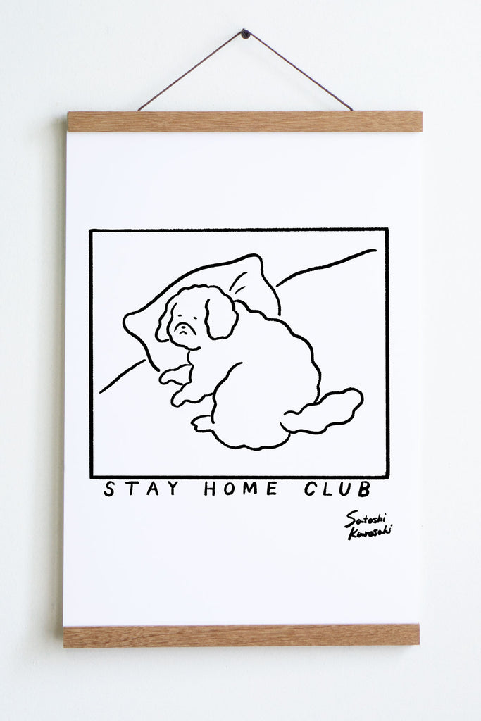 black outline in square of dog laying on pillow with text underneath that reads stay home club and satoshi  kurosaki