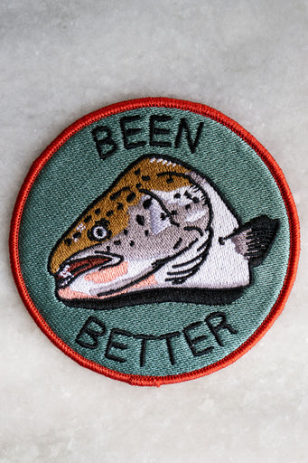 "Round embroidered patch with a fish head design and the words ""Been Better"""
