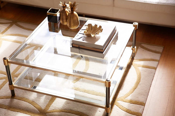 Brass coloured clam shell and brass pineapple on coffee table