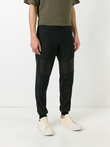 Pants with leather detail