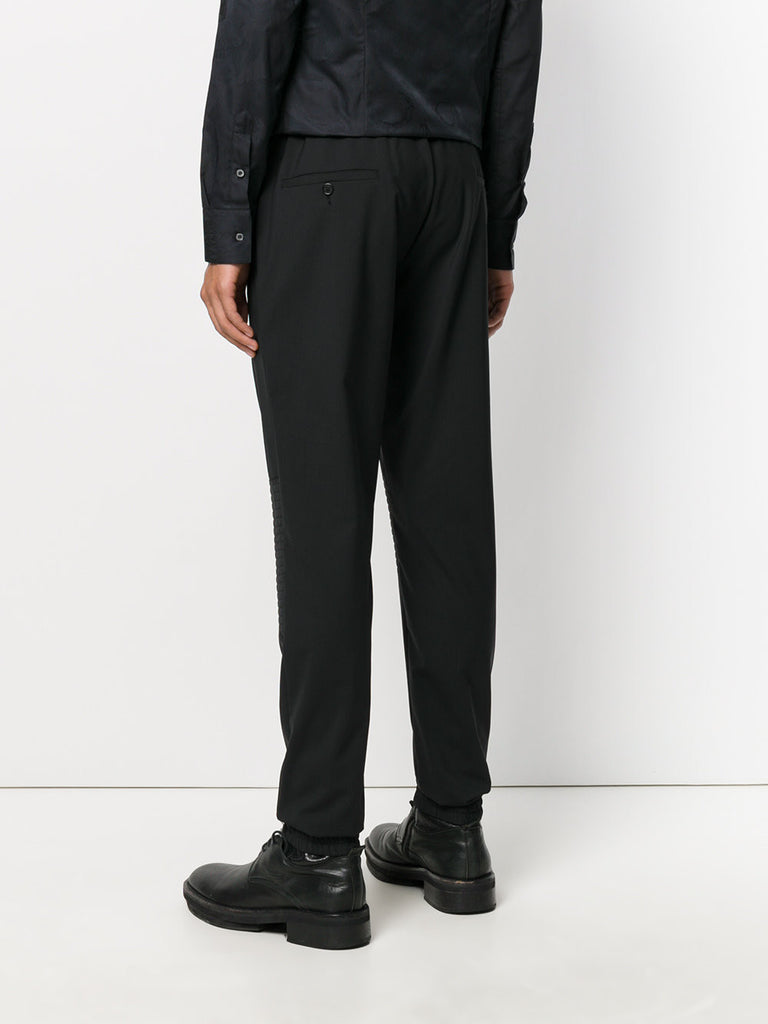 BLACK TRACKPANTS WITH STICHES ON THE KNEES FROM PHILIPP PLEIN