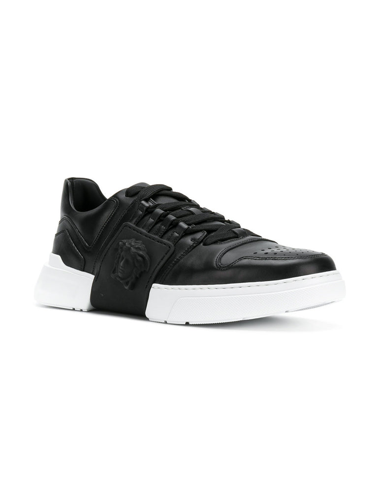 Black low leather sneakers from Versace