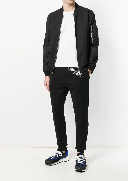 BLACK TRACKPANTS WITH BLACK LOGO PRINT FROM MOSCHINO
