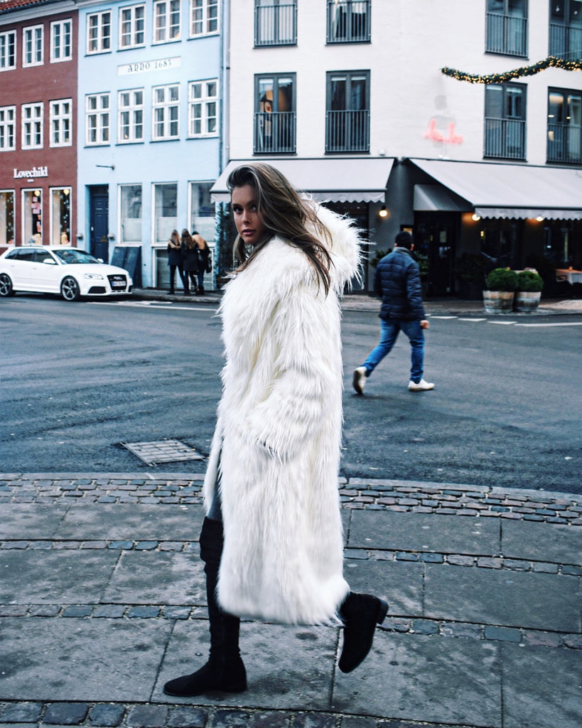 Faux long fur in white with hood