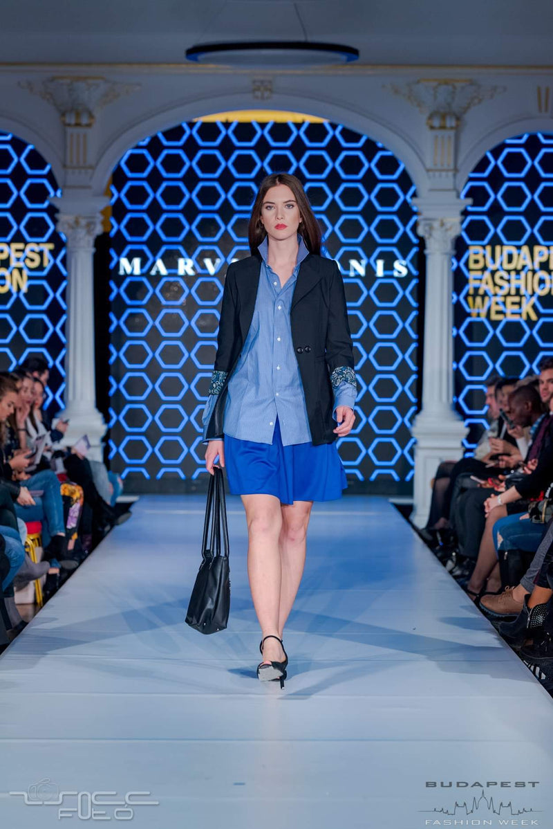lack Jacket, Blue Shirt, Blue Skirt - Walking along the stage