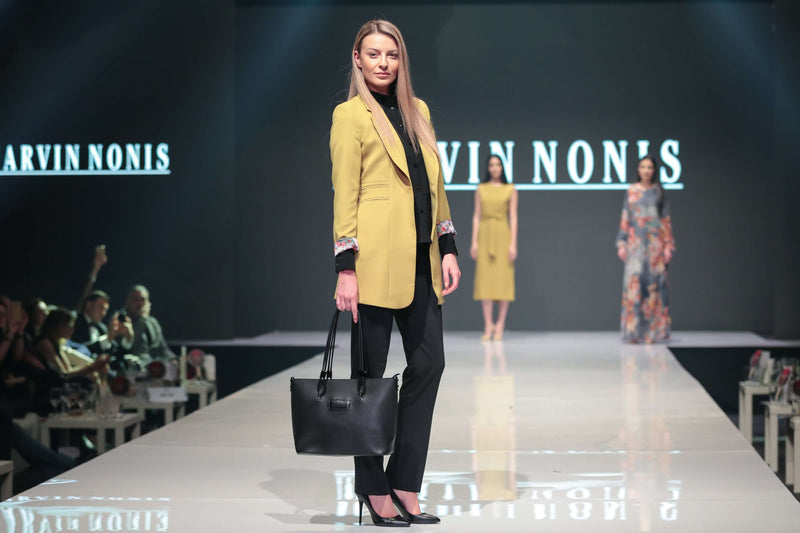 Black Blouse, Trousers and Mustard Coloured Jacket - side pose