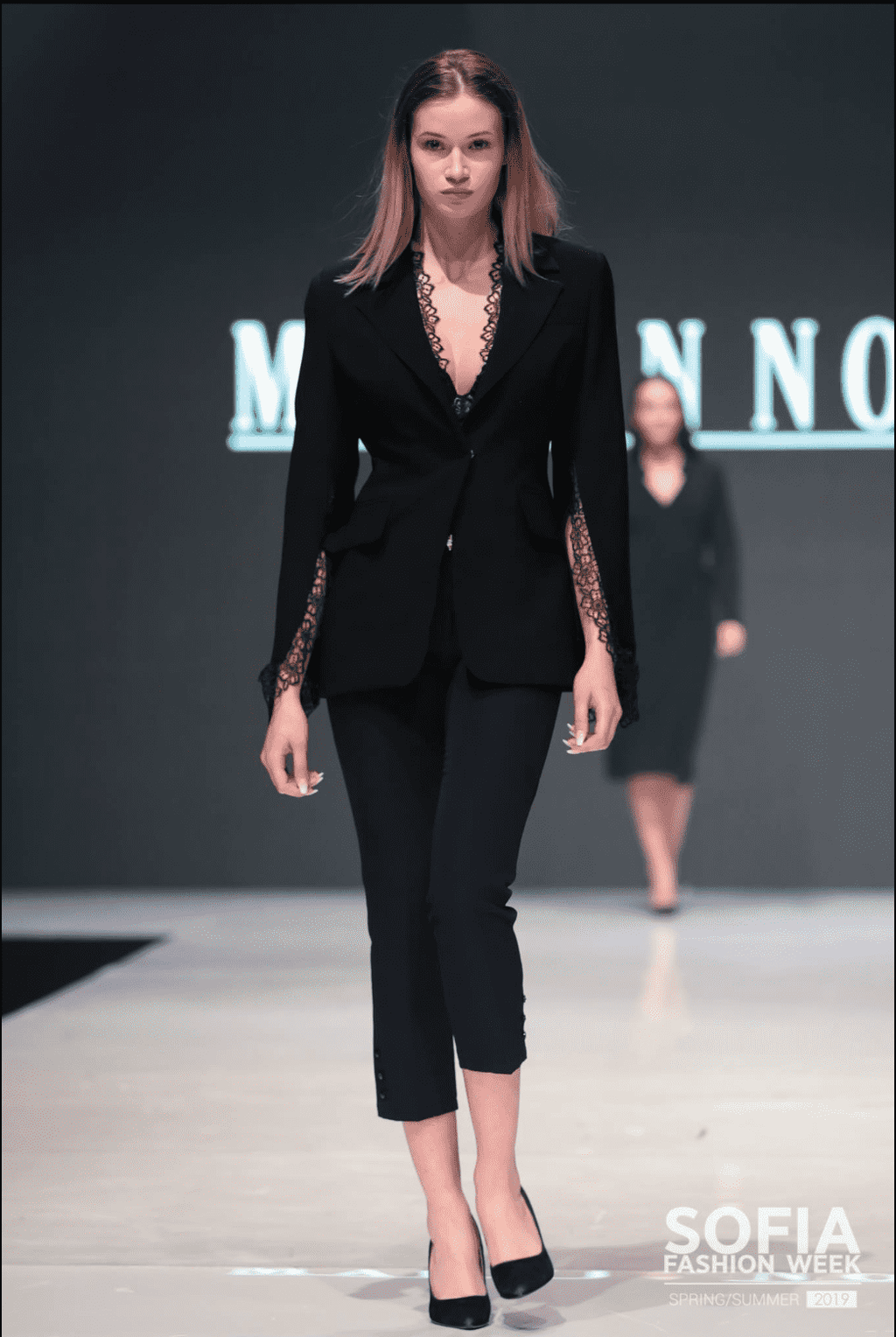 Black Suit with Lace Trimmings