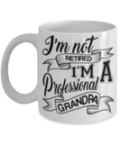 I'm not RETIRED..I'm A Professional GRANDPA Coffee Cup - Premium 11 oz White coffee cup