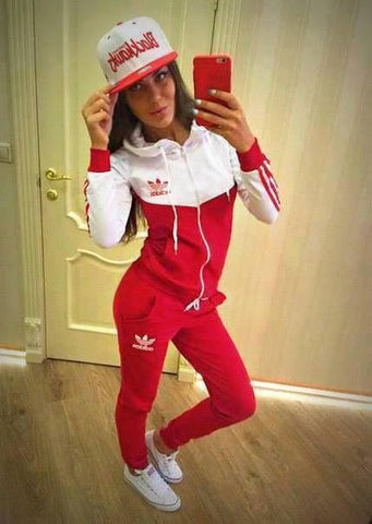 Tracksuit sports wear red white top and sleeves , front zip and hoodie
