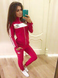 Tracksuit sports set in red  - zip and white line up in front