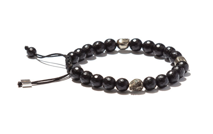 Onyx Accented with Skulls and Silver Bracelet