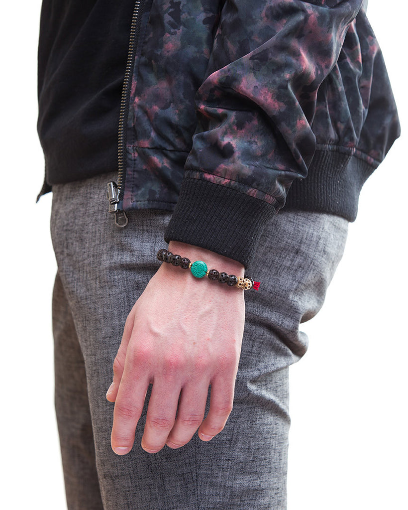 Cinnabar, bone, and onyx bracelet on male model