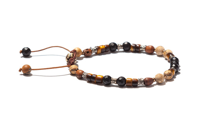 Varied Beaded Bracelet with Wood Skulls and Silver