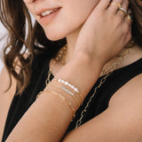 Model shown wearing the Gold Chain and Silver with CZ Bar Option