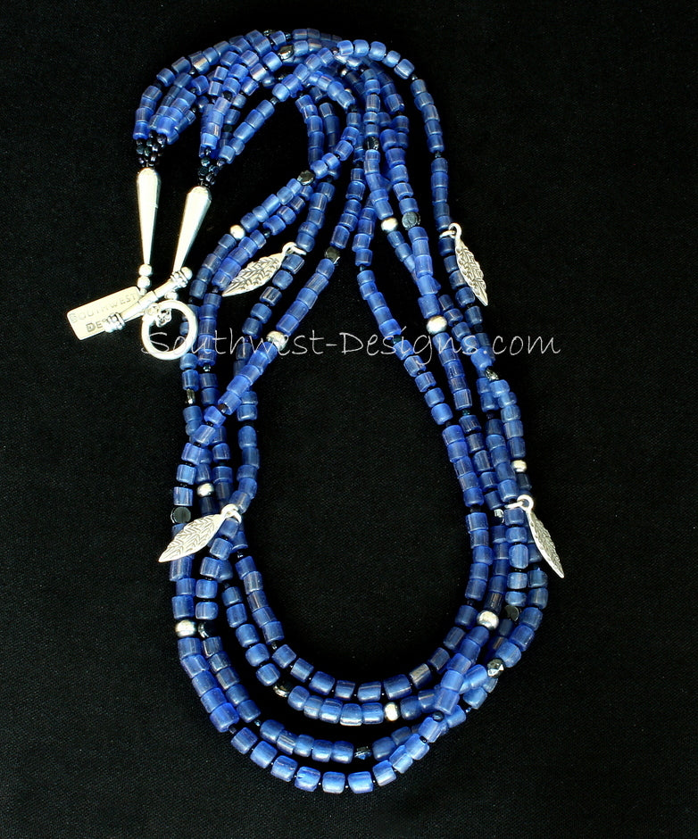 Blue Indonesian Glass 4-Strand Necklace with Hill Tribe Silver Leaf Charms, Vintage Czech Nailheads, and Oxidized and Polished Sterling Silver