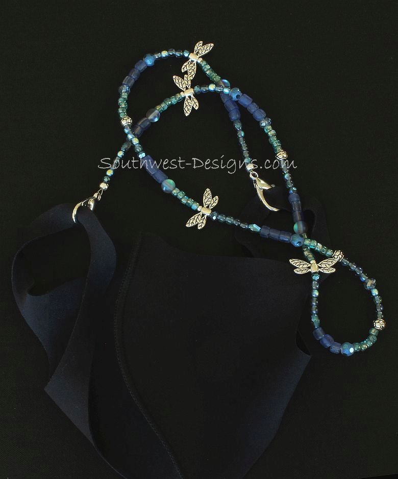 Indonesian Glass and Czech Glass Mask Lanyard with Blue Crystal Rounds and Plated Silver Dragonflies and Ornate Drum Beads