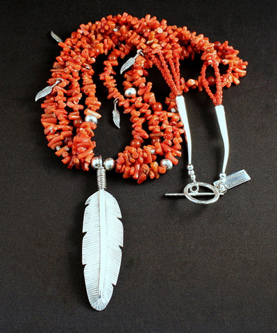 Sterling Silver Feather Pendant with 4 Strands of Italian Coral Cupolini, Carnelian Rounds, Sterling Feather Charms, and Sterling Silver Beads, Cones & Toggle Clasp