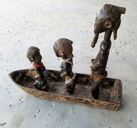 Bauli carved boat Statue family