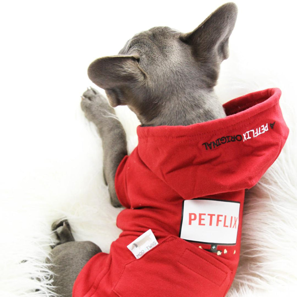 Dog wearing red dog hoodie with Petflix Text - Red Netflix Original Dog Hoodie