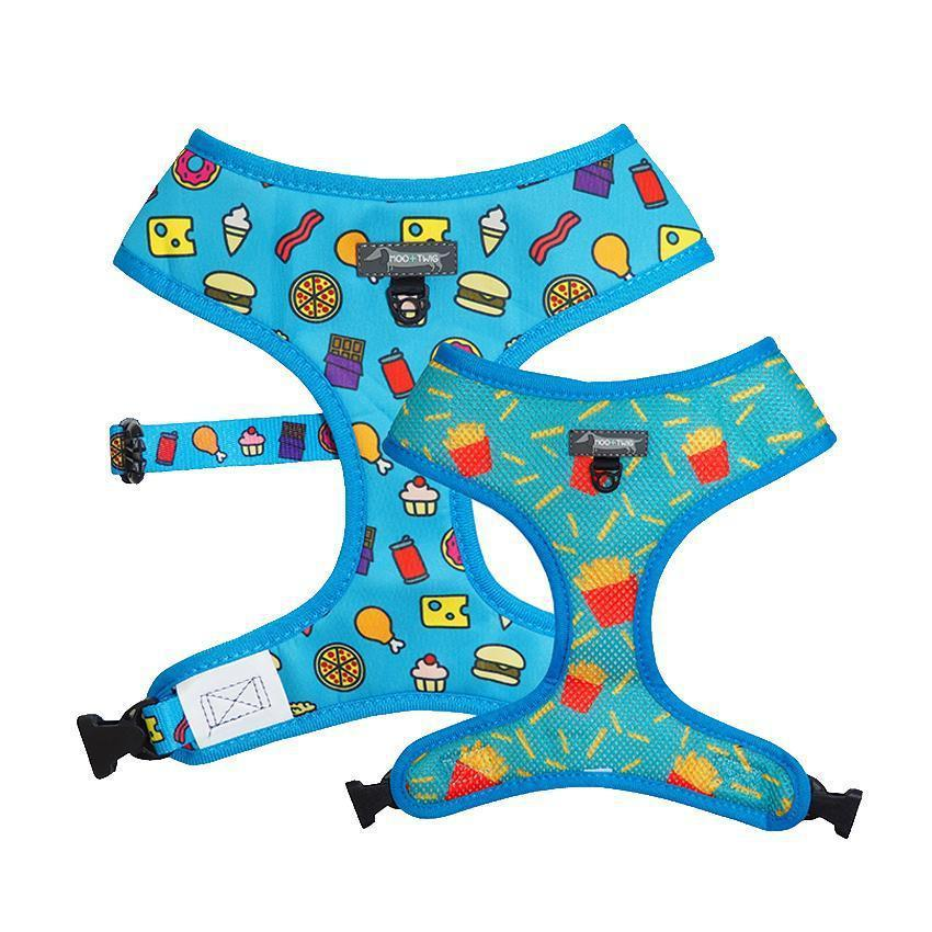 Blue reversible dog harness with junk food and french fries.