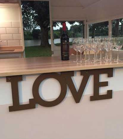 Timber 'LOVE' sign