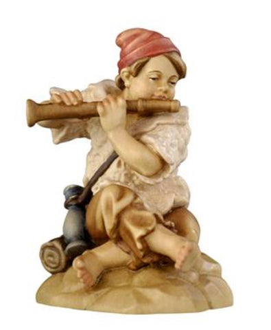 Rainell Boy Sitting with Flute