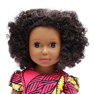 Black doll with curly natural hair. Medium brown skin tone