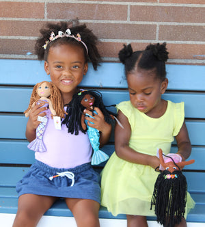 Girls playing with Ikuzi Doll Mermaids